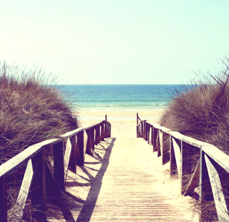 Photo of a walkway down to a beach.