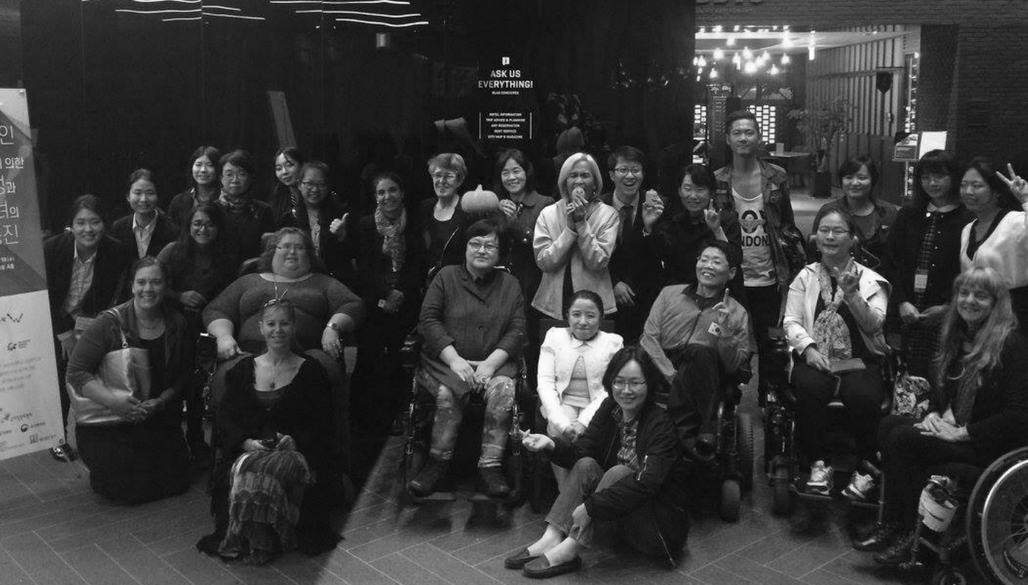 Photo of group of women with disability at conference.