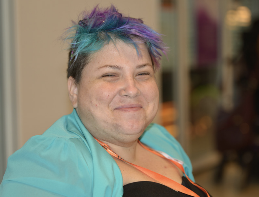 Photo of woman with disability who attended National forum.