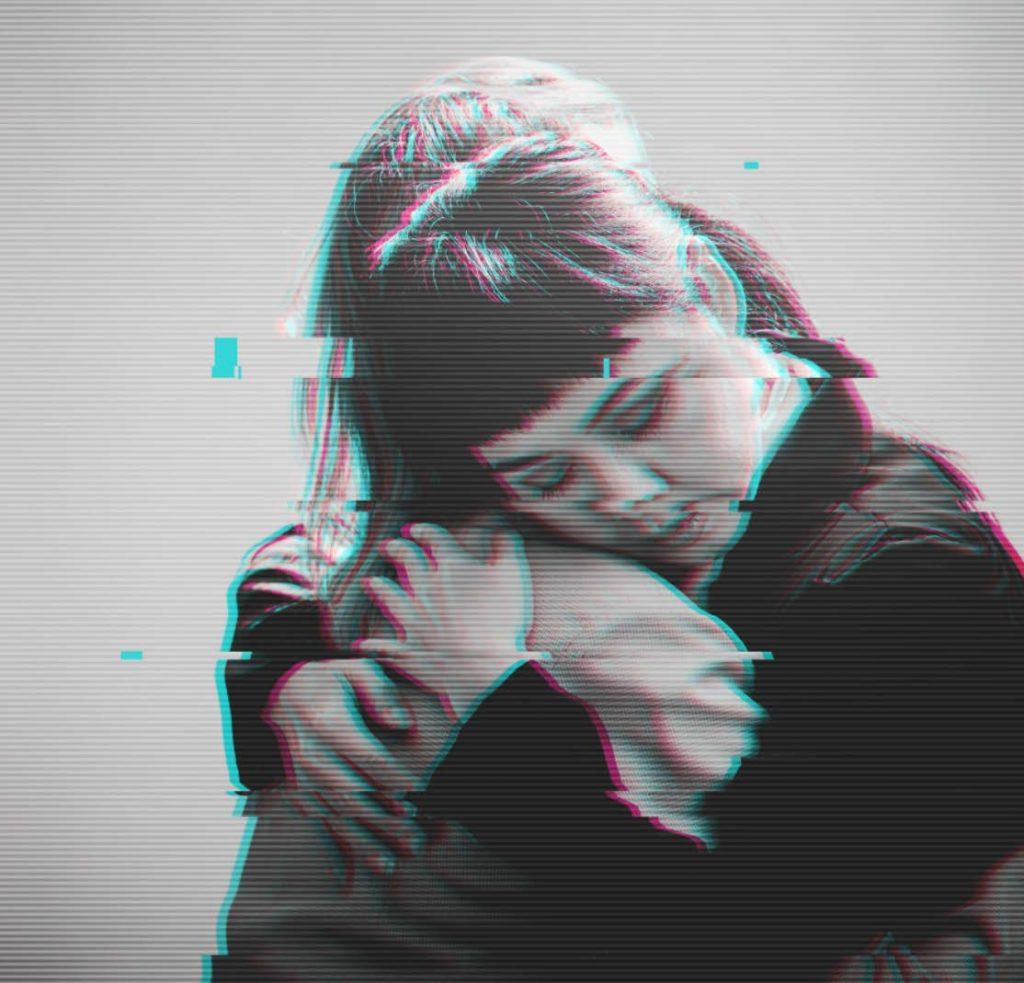 Greyscale image of two women hugging.