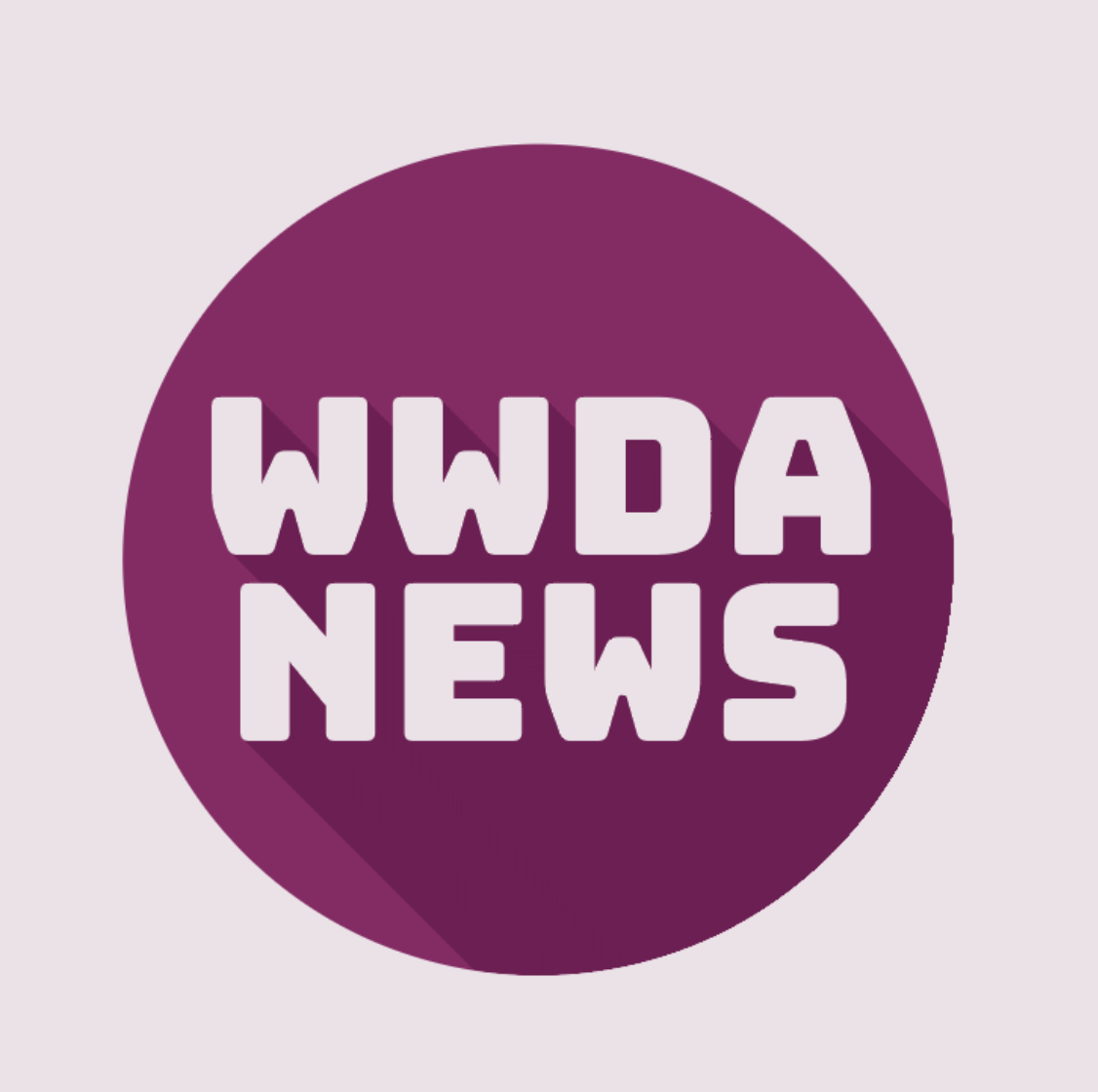 Purple cirlce with pink text: 'WWDA News.'