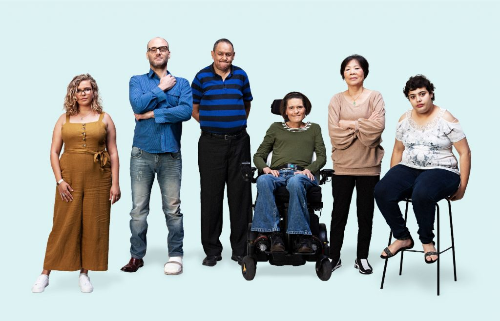 6 people with disability standing in a line against a blue background.