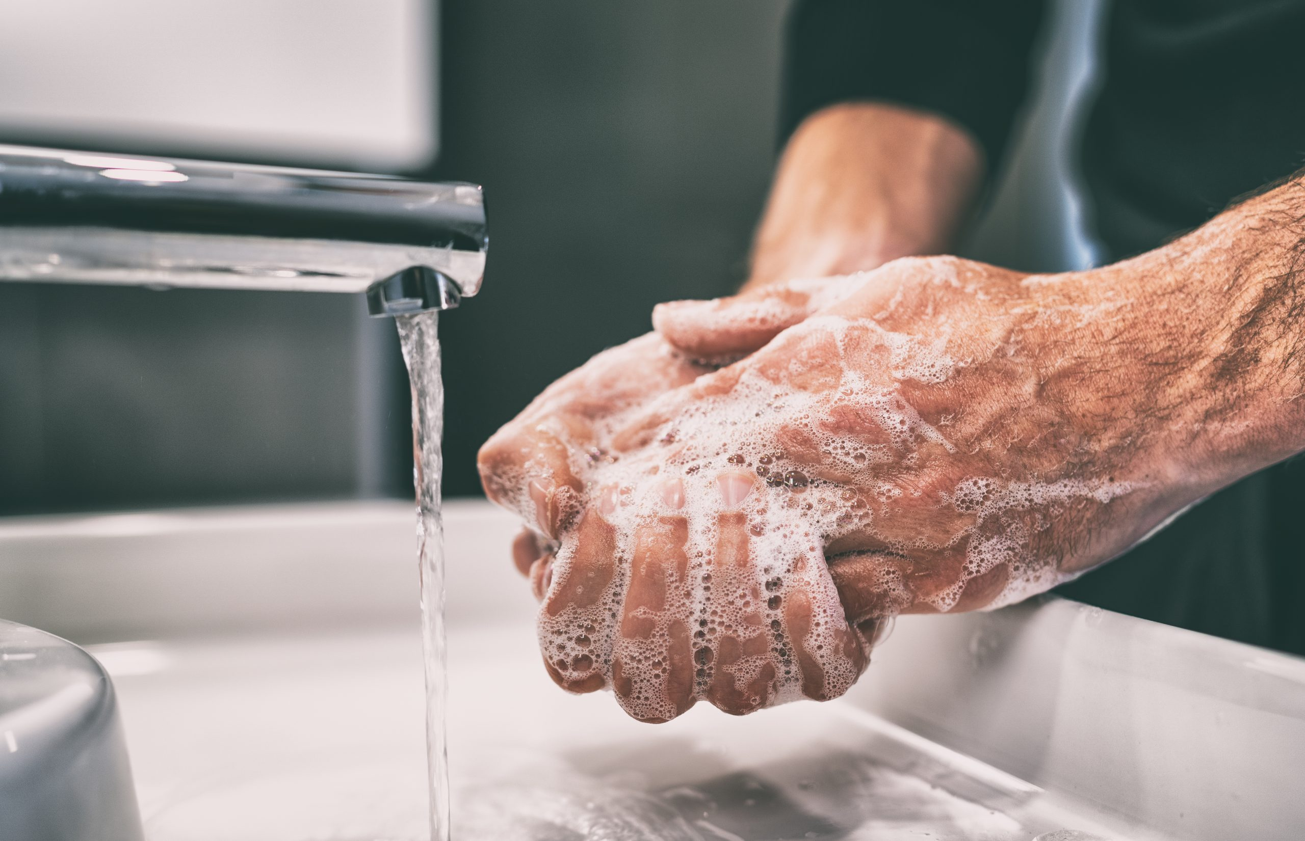 Photo of a person washing their hands.