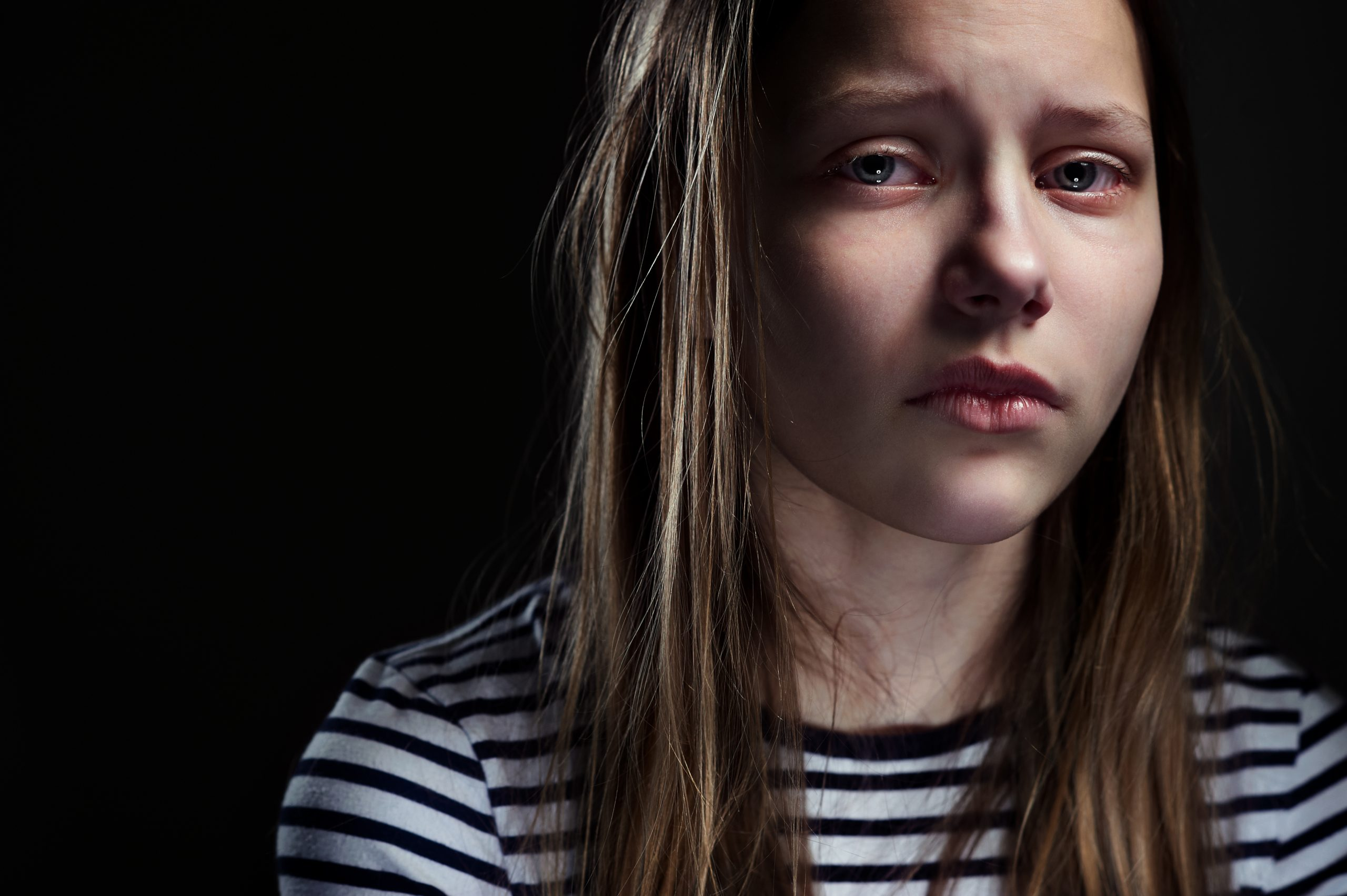 Photo of young woman looking sad.