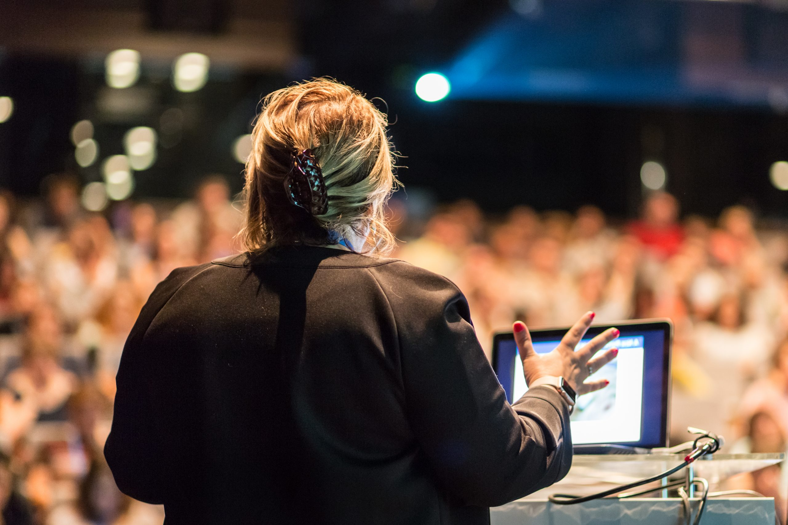Photo of a woman speaking to a crowd.