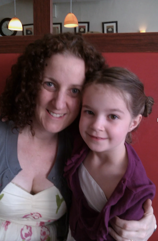 Photo of young Issy (right) with their mum (left).