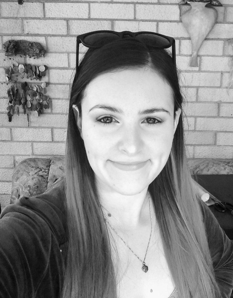 A black and white photo of Bethany who has long brown hair and smiling
