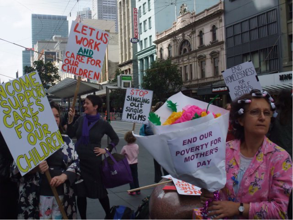 A photo of Helen (right) in 2010, protesting in a crowd with the Council of Single Mothers.