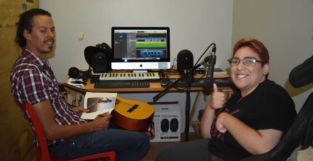 Photo of Steve Carillo and Amy James working on Amy's music compilations.