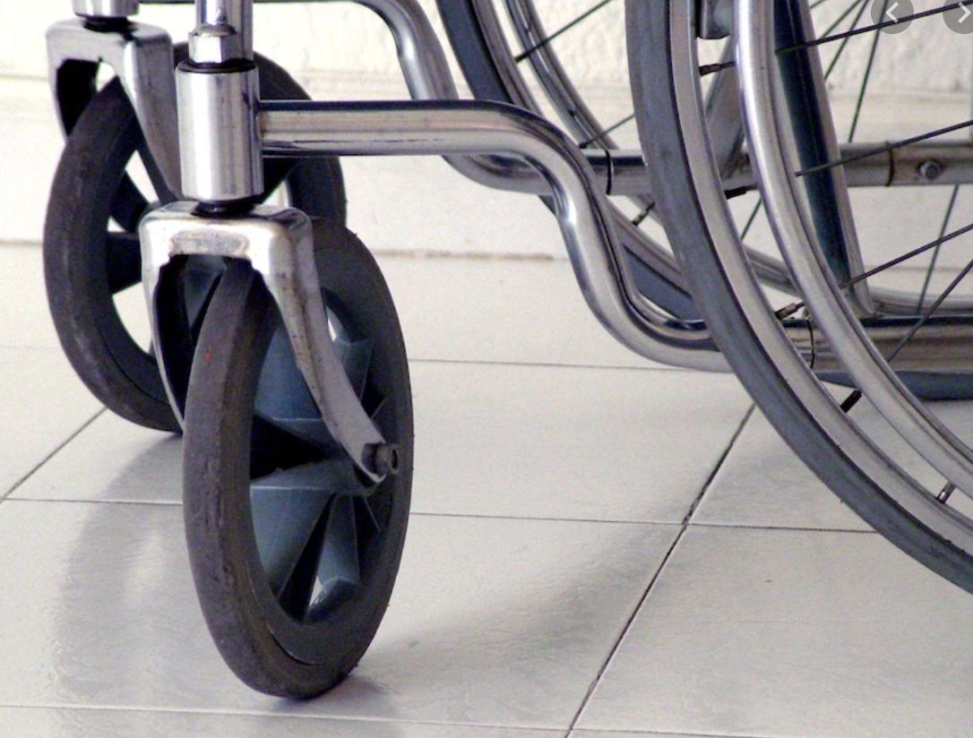 A wheelchair on a tile floor